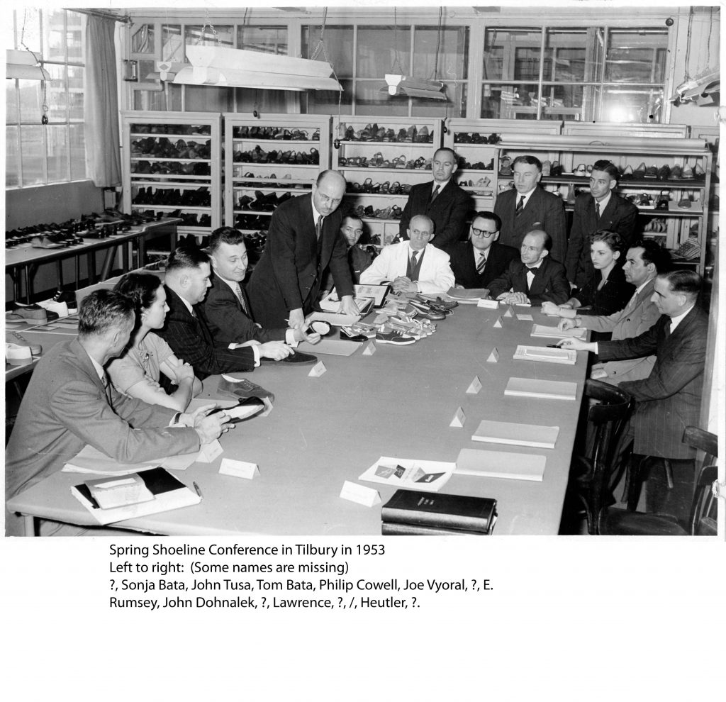 Senior Bata management discussing designs at the Spring Shoeline Development 1953 in East Tilbury